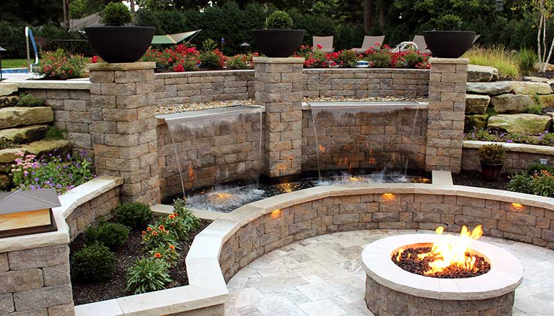 Firepit, Backyard Patio, Water Application, Lighting, Retaining Wall,  Concrete Block Wall