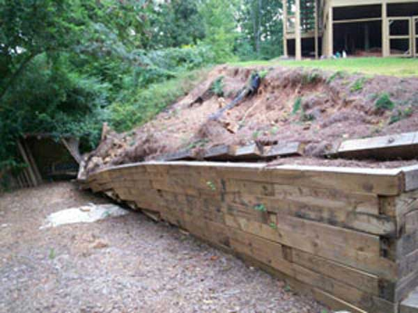 failing treated timber wall