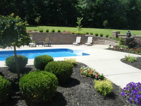 Genial Backyard With Pool With Patterned Retaining Wall