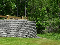 Curved retaining wall with road above