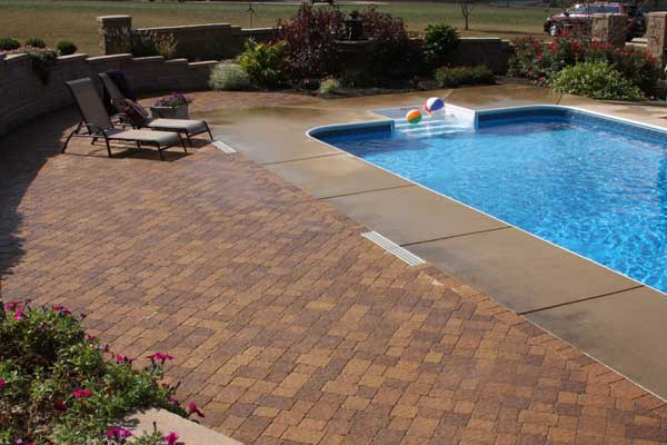 Paver Patio With Pool Surrounded By Retaining Wall And Privacy Concrete Two  Sided Fence