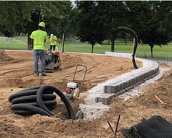 wall construction with drainage pipe