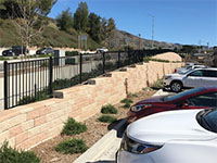 Stepped up retaining wall along road