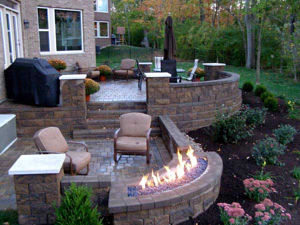 raised patio with allan block retaining wall blocks